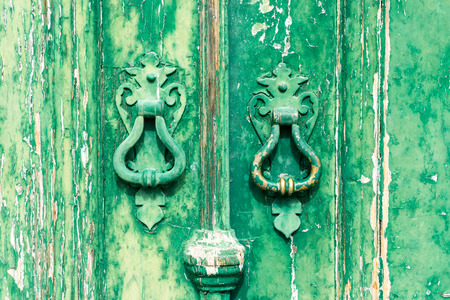 portugese: Colorful door with door knockers in a typical Portugese house Stock Photo