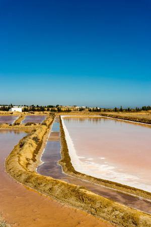 formosa: The ancient technology adapted to the landscape of the Ria Formosa turns the salt pans into outdoors chemistry labs Stock Photo