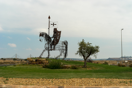 metal sculpture: Metal sculpture of a knight on horseback stands proud on the roundabout outside of Castro Marim