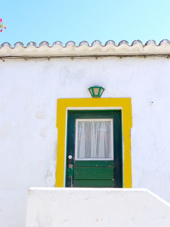 portugese: colorful door in a typical Portugese house situated in Cacela Velha