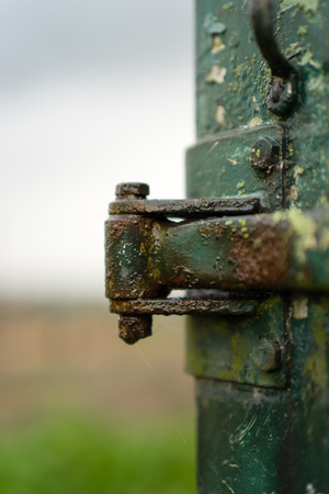 weather-beaten old hinge on a cart in the rain