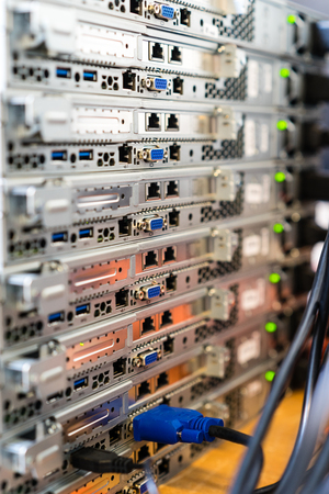 Pile of servers with shallow depth of field in a data room