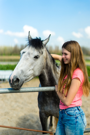 young teenage girl with horse