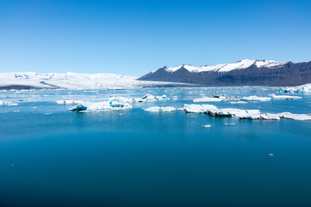 The large glacier lagoon is a unique place with icebergs constantly breaking off from the glacier and eventually drifting through the short river to the sea