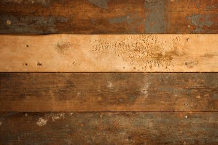 グランジ背景の古い木製のスラットを着用