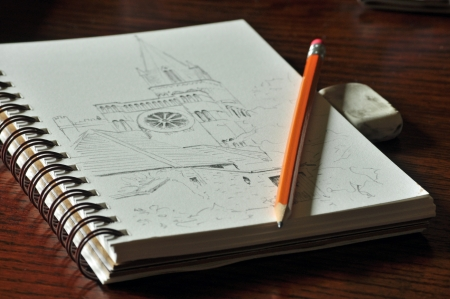 Pencil sketch of church, with pencil, eraser, and sketchbook