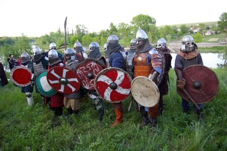 armed medieval knights in armor preparing for battle photo