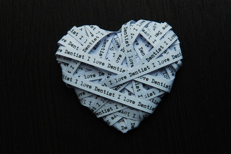 showed: White paper ribbon in heart shape showed text