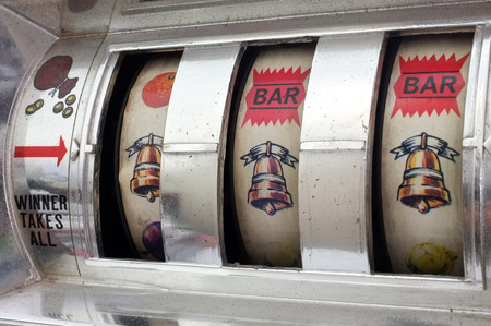 Slot machine with three bells jackpot Stockfoto