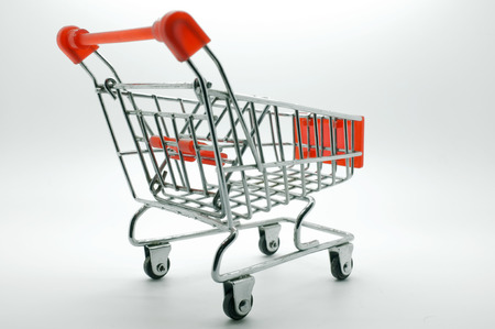 Empty shopping cart, side view, on white background photo