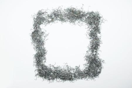staple: Used staple needle in shape of square, rectangular frame Stock Photo