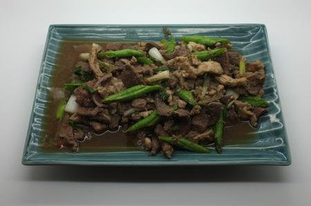 long bean: Stir fried pork liver with yard long bean thai food Stock Photo