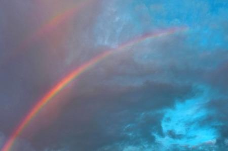 rainbow sky: Rainbow over blue sky Stock Photo