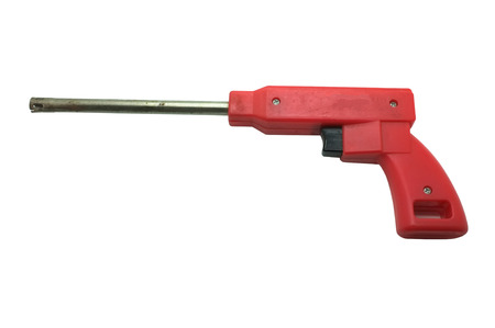 gas lighter: Red gas lighter in shape of gun isolated on white background