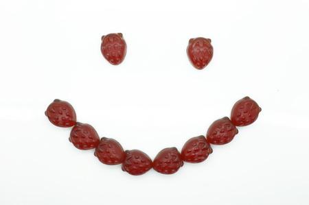 gummi: Smile of gummi red strawberry jelly Stock Photo