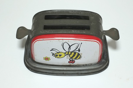old fashioned: Old Fashioned Toaster toy with bee cartoon Stock Photo