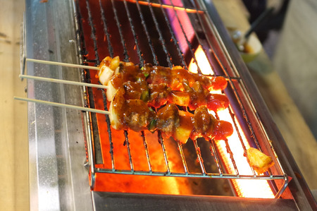 coals: Assorted grilled meat with vegetable over coals on barbecue