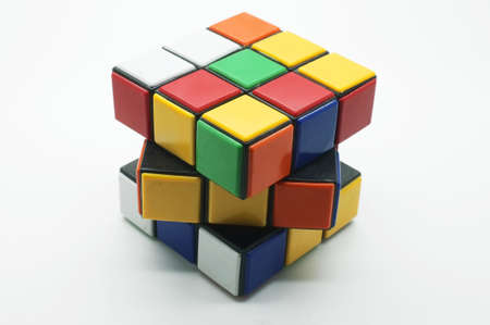 unsolved: Colorful puzzle Cube isolated on white background, magic cube