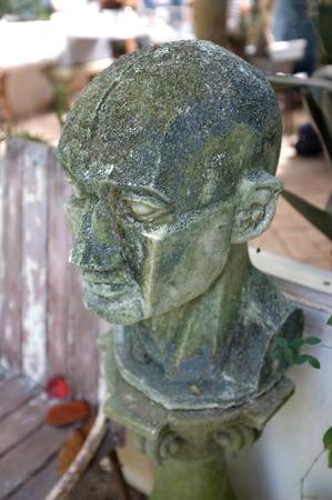 mediteranean: Sculpture covered with moss in garden