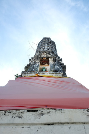architech: Ancient stupa in temple of Thailand with blue sky background