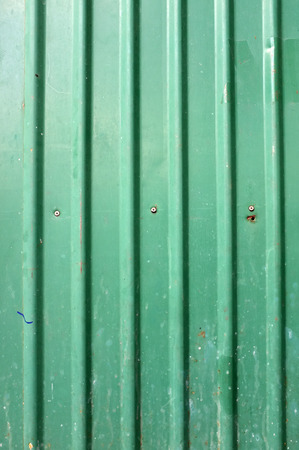 tile cladding: Green corrugated metal with bolts