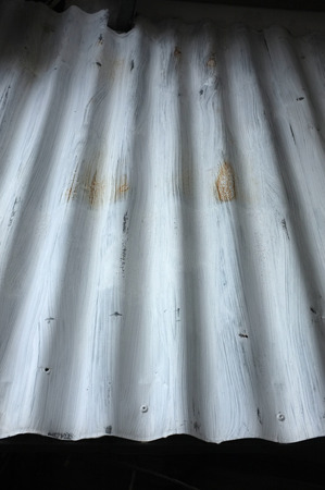 corrugated metal: Silver corrugated metal with bolts Stock Photo