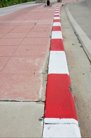 emergency lane: red withe strip on foothpath , Thailand Stock Photo