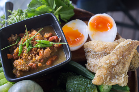 Chili paste mixed with crabmeat , vegetable , Fried Snake Skin Gourami  and   Boiled Egg  , Crabs Spawn Chili Sauce