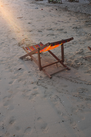deckchair: Deckchair on the sand beach during sunset