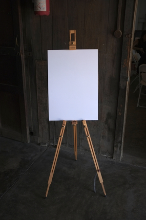artboard: Blank white art board wooden easel, front vie Stock Photo