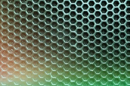perforated: Steel grating of loudspeaker ,full frame black grid of a speaker texture , effect green neon fade , concept music , concert