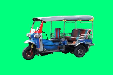 Thailand three wheel native taxi on green background , Thailand Tuk Tuk