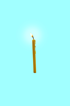 Orange candle or orange paraffin or wax burning party candle for retouch. Concept Happy new year , happy birthday , scary