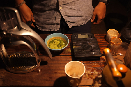 Barista making green tea ingredient for green tea latte