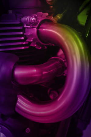 Colourful motorcycle engine close-up detail background