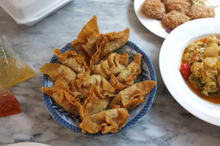 Deep Fried Pork Wonton or (Thai name is Giew Moo Tod) on dish