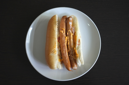 Delicious HotDog with a hot grilled sausage, fried bacon, cheese sauce , Concept fastfood