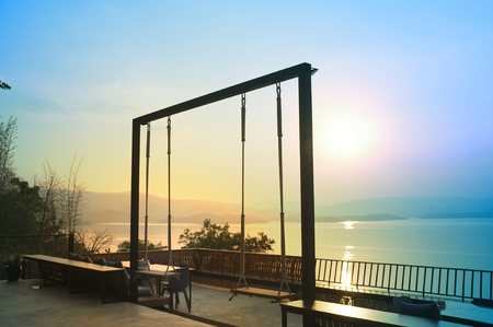Wood swing of beautiful sunset on Khuean Srinagarindra National Park at Kanchanaburi , Thailand and sky for travel in holiday relax time Stockfoto