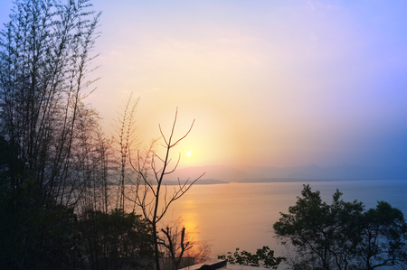 Beautiful environment of  beautiful sunset on Khuean Srinagarindra National Park at Kanchanaburi , Thailand and sky for travel in holiday relax time