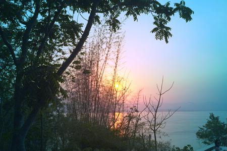 Beautiful environment of  beautiful sunset on Khuean Srinagarindra National Park at Kanchanaburi , Thailand and sky for travel in holiday relax time 版權商用圖片 - 124718901