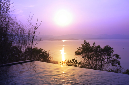 Swimming pool terrace and beautiful nature view ,sunset on Khuean Srinagarindra National Park at Kanchanaburi , Thailand and sky for travel in holiday relax time 版權商用圖片 - 124718943
