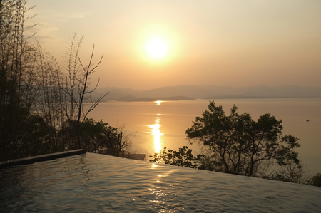 Swimming pool terrace and beautiful nature view ,sunset on Khuean Srinagarindra National Park at Kanchanaburi , Thailand and sky for travel in holiday relax time