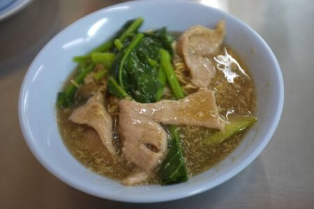 Deep Fried Egg  Noodle with pork in gravy. THAI FOOD
