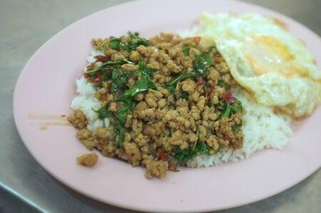 Thai food , Stir fried Thai basil with minced pork and a fried egg Stock Photo