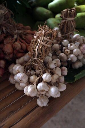 Garlic on market table closeup photo 写真素材