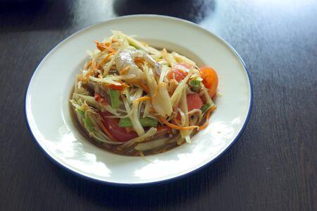 The famous local Thai street food ,Thai papaya salad or what we call  Somtum