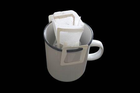 Drip bag fresh coffee on cup Stockfoto