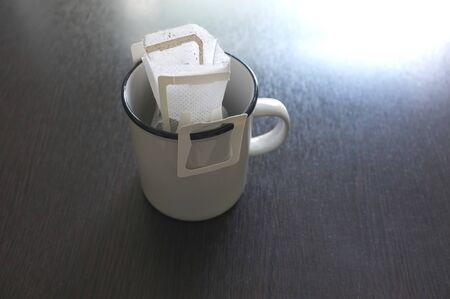 Drip bag fresh coffee on cup .