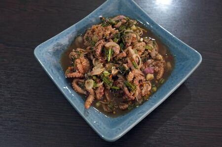 Thai cuisine , spicy minced squid salad .