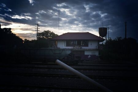 A colorful sunup above a small train station in thailand  Stock Photo